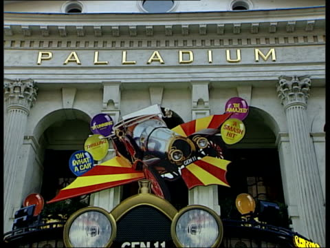 charity gala event london palladium theatre facade with 'chitty chitty bang bang' advertising - west end london stock videos and b-roll footage