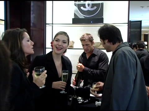 milo addica and laura harring at the chanel premiere of baz luhrmann's no 5 the film at chanel store in beverly hills california on october 20 2004 - laura harring stock videos & royalty-free footage