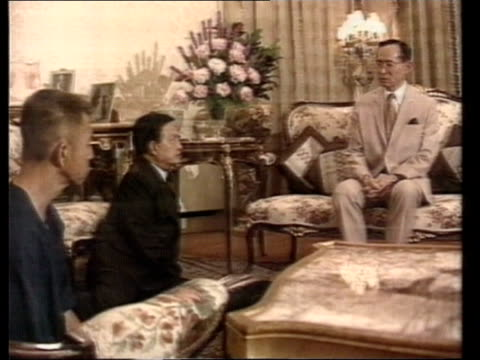 miltary clampdown thailand bangkok ms thai pm general suchinda kraprayoon on knees with opposition chamlong srimuang next to king buhmibol of thailand - king of thailand stock videos and b-roll footage