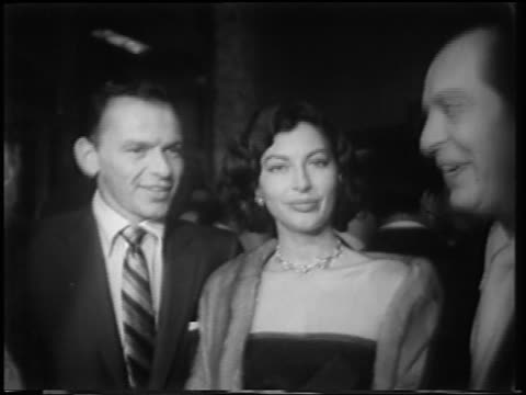 "milton berle kissing ava gardner as frank sinatra looks on at ""meet danny wilson"" premiere - frank sinatra stock videos & royalty-free footage"