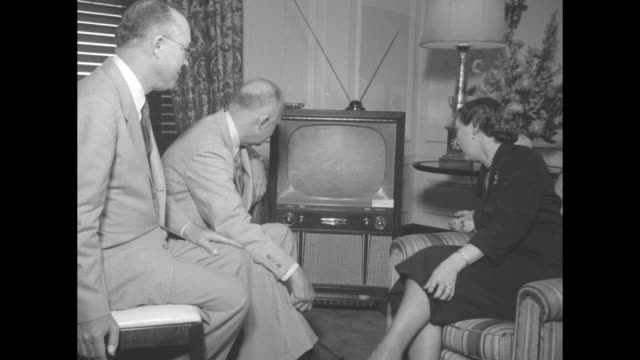 Milton Dwight and Mamie Eisenhower watch TV set during the Republican National Convention / Note exact day not known