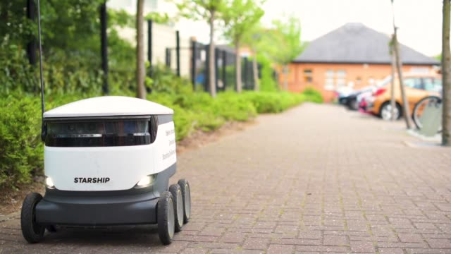 milton keynes coops trial use of starship delivery robots to deliver groceries to customers' homes - futuristic stock videos & royalty-free footage