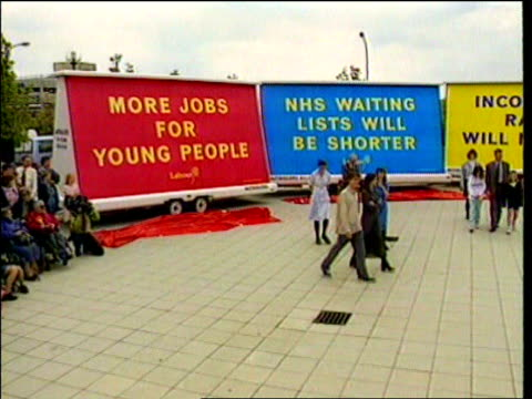 ext labour party lorry hoardings set in semicircle pan to tony blair speaking on soap box during general election campaign - semi circle stock videos & royalty-free footage