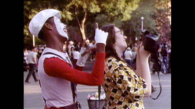 mime artist helps woman to take photograph in new york; 1987 - mime artist stock videos & royalty-free footage