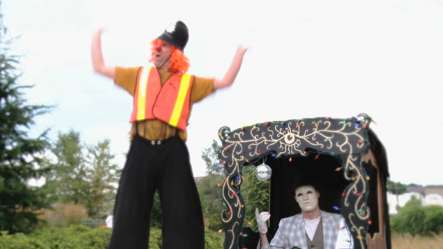 ms mime in booth and clown on stilts /  mississauga, ontario, canada. - mime artist stock videos & royalty-free footage