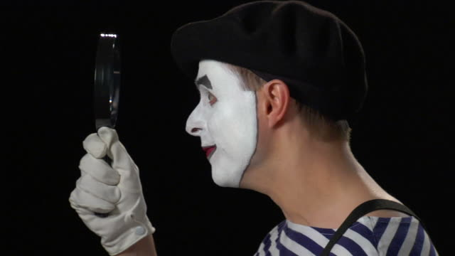 mime magnifying glass - good news - formal glove stock videos & royalty-free footage