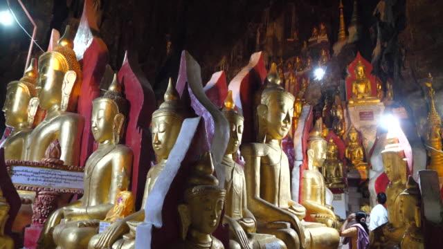 minamar (burma),pindaya, the pindaya caves (grotto buddhist shrine) - grotto cave stock videos and b-roll footage