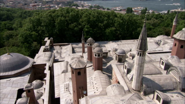 minarets spires and domes characterize the rooftops of the topkapi palace in istanbul. available in hd. - topkapi palace stock videos and b-roll footage