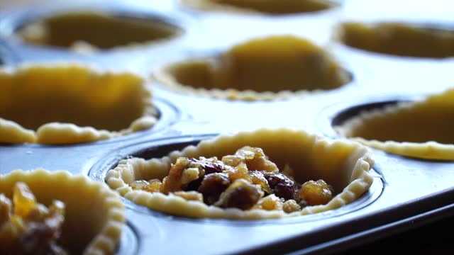 mince pies are a favourite festive treat filled with fruits and spices typical of the time of year. the ingredients date back to the european... - spice stock videos & royalty-free footage