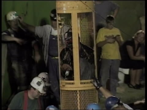 mine capsule hoists a trapped miner to safety. - 2002 stock videos & royalty-free footage