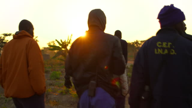mine sweepers from angola walk during sunset - minesweeping stock videos and b-roll footage