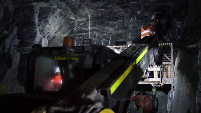 Mine workers use an elevated work platform to lay explosives in the underground tunnels inside the Curraghinalt gold project operated by Dalradian...