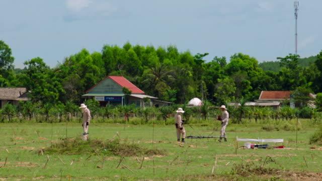 minefield being cleared in vietnam - 宝探し点の映像素材/bロール