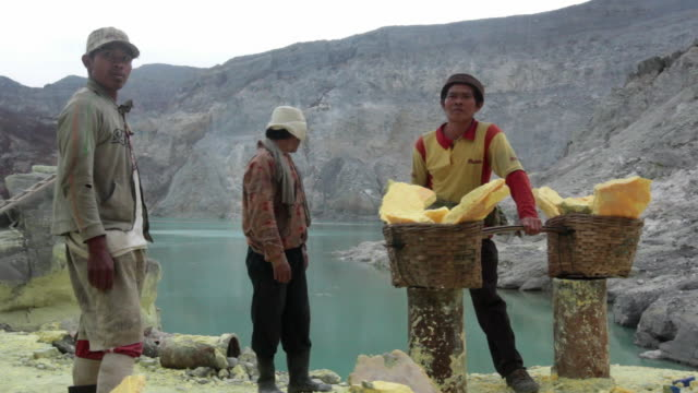 MS Miner after collecting the sulfur at the Ijen volcano crater / Ijen, Java, Indonesia