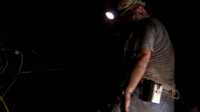 a miner arranges detonating cords in a mine shaft. - mine shaft stock videos and b-roll footage