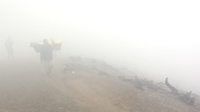 MS Miner climbing carrying solid sulfur / Ijen, Java, Indonesia