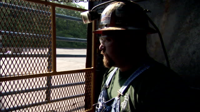 a miner opens a gate as he exits an elevator. - miner stock videos & royalty-free footage