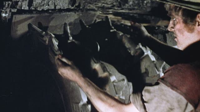 1973 montage miner preparing anderton shearer loader and the machine slicing coal from the face of an underground mine tunnel / england, united kingdom - coal mine stock videos & royalty-free footage