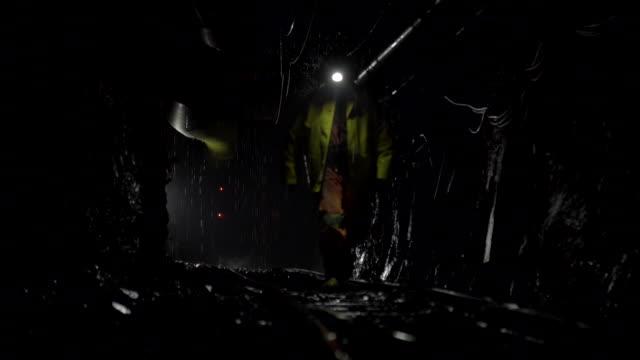 miner walks on mine railway - mine stock videos and b-roll footage