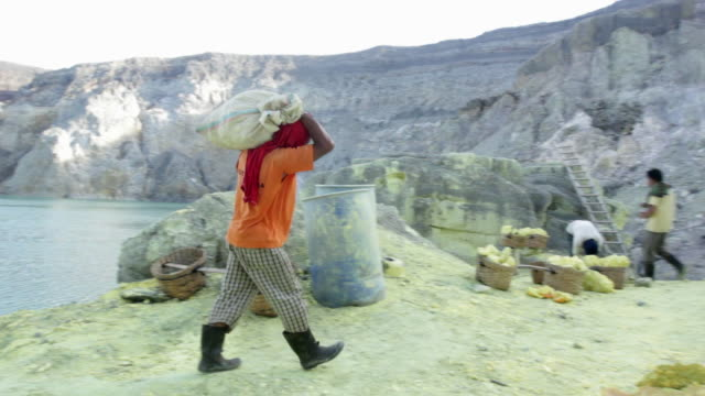MS PAN TD Miner working at the sulfur extraction on the Ijen volcano next to liquid sulfur / Ijen, Java, Indonesia