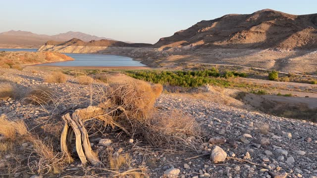 mineral-stained rocks are shown at echo bay on june 21, 2021 in the lake mead national recreation area, nevada. the u.s. bureau of reclamation... - western usa stock videos & royalty-free footage