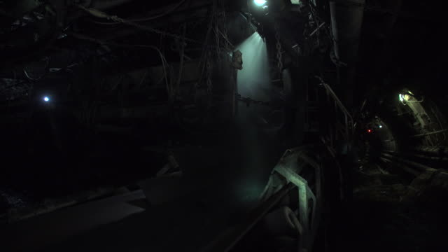 miners at work inside pniowek coal mine in poland - coal mine stock videos & royalty-free footage