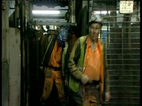 Miners exiting lift at end of shift Ellington Colliery Northumberland; Mar 2004
