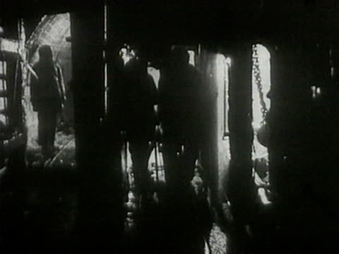 miners inside coal mine going up out of the mine on elevator workers walking on stairs - 1920 stock videos & royalty-free footage