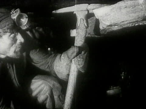 miners moving minecarts inside coal mine worker crawling in the dark with lantern horse drawn coal carts miner working with sledgehammer - 発電所関係の職業点の映像素材/bロール