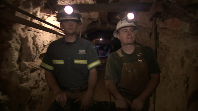 miners push a cart through a mine. - miner stock videos & royalty-free footage
