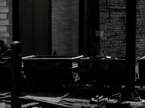 miners push coal trucks along a track 1960 - coal mine stock videos & royalty-free footage