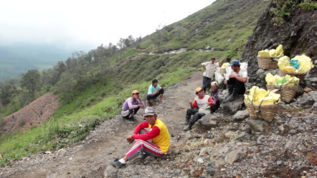 WS Miners resting on their way to the mining / Ijen, Java, Indonesia