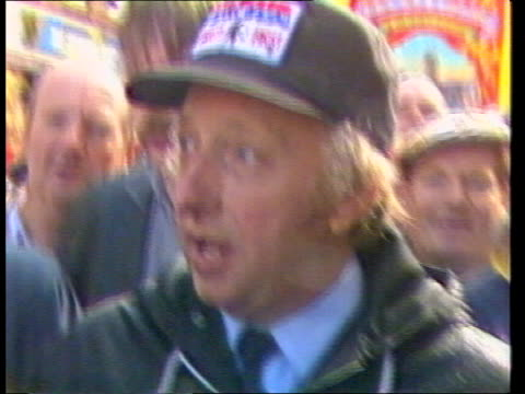 day 194 Miners strike day 194 ENGLAND Stoke on Trent LMS Scargill leading NUM marchers TOWARDS TMS Marchers along street MS Huge banner carried by...