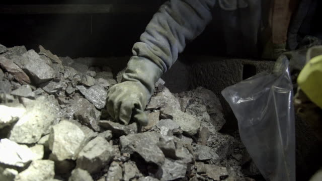 cu of miners taking rock samples in mine tunnel - mine stock videos & royalty-free footage