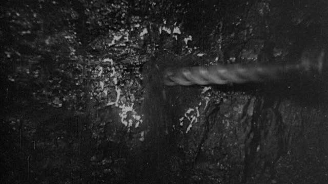 1978 montage miners underground cutting by hand, jib cutting, drilling, charging and shot firing coal then loading it onto a conveyor / united kingdom - mining natural resources stock videos and b-roll footage