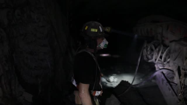 miners use a remote control to help a machine excavate copper ore at the digging face in the underground mine operated by kghm polska miedz sa in... - copper mine stock videos and b-roll footage