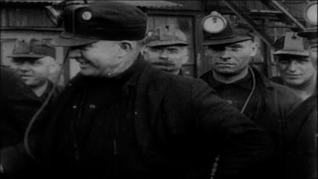 miners with battery powered head lamps, 1920s - minatore video stock e b–roll