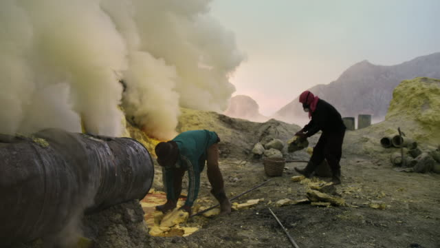 miners work at a sulphur mine, jawah ijen - mineral stock videos & royalty-free footage