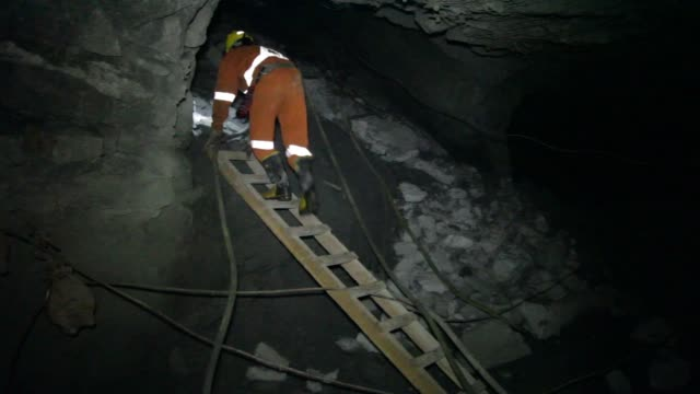miners work underground at the glencore operated bracemac mcleod zinc and copper mine in quebec canada on september 11th 2015 shots miners travel... - copper mine stock videos and b-roll footage