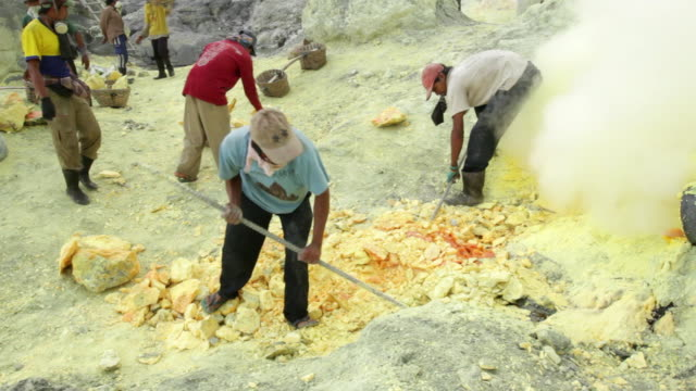 ms miners working on the sulfur extraction at ijen volcano crater / ijen, java, indonesia - miner stock videos & royalty-free footage