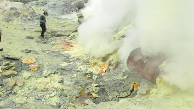 ms miners working on the sulfur extraction at ijen volcano crater / ijen, java, indonesia - land mine stock videos and b-roll footage