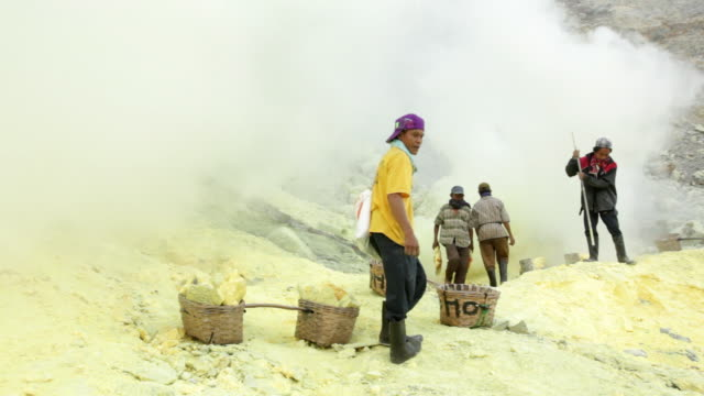 MS PAN Miners working on the sulfur extraction at Ijen volcano crater / Ijen, Java, Indonesia