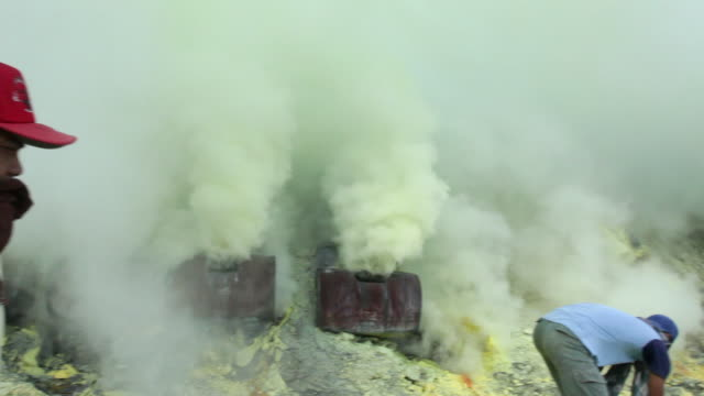 ms tu pan miners working on the sulfur extraction at the ijen volcano / ijen, java, indonesia - land mine stock videos and b-roll footage