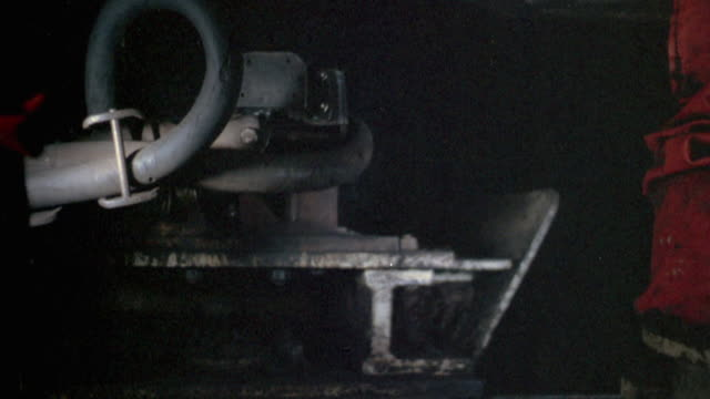 vidéos et rushes de 1978 montage miners working with various coal extracting equipment underground / united kingdom - mineur de charbon