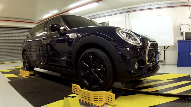 mini car having its suspension tested - quality control stock videos and b-roll footage