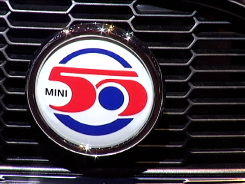 mini cooper camden front end / grille emblem / kiosk sign / front three-quarter passenger side view / camden badge and sidelight / dashboard from... - dreiviertelansicht stock-videos und b-roll-filmmaterial