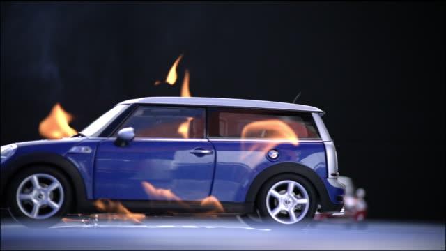Mini Cooper drives through flames