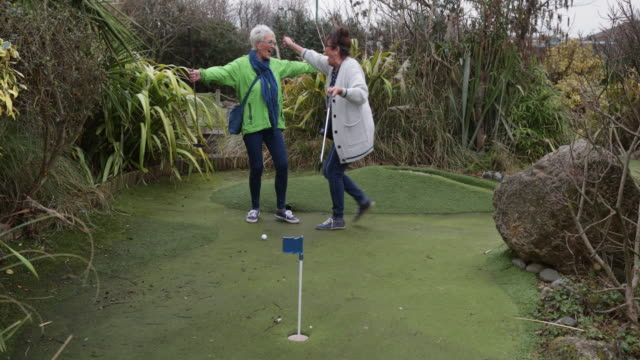 mini golf with friends - holing stock videos & royalty-free footage