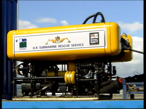 Mini submarine trapped under ocean SCOTLAND Prestwick Airport MS Name 'UK Submarine Rescue Service' on side of remote controlled submersible Scorpio...