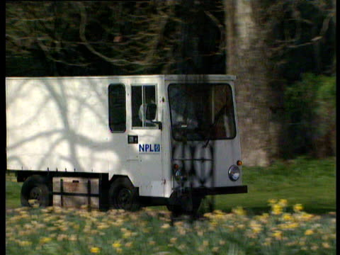 stockvideo's en b-roll-footage met mini van driving through leafy grounds and up to main entrance of national physical laboratory - van